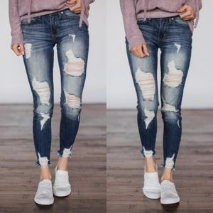CAMILLA Distressed Skinny Jeans